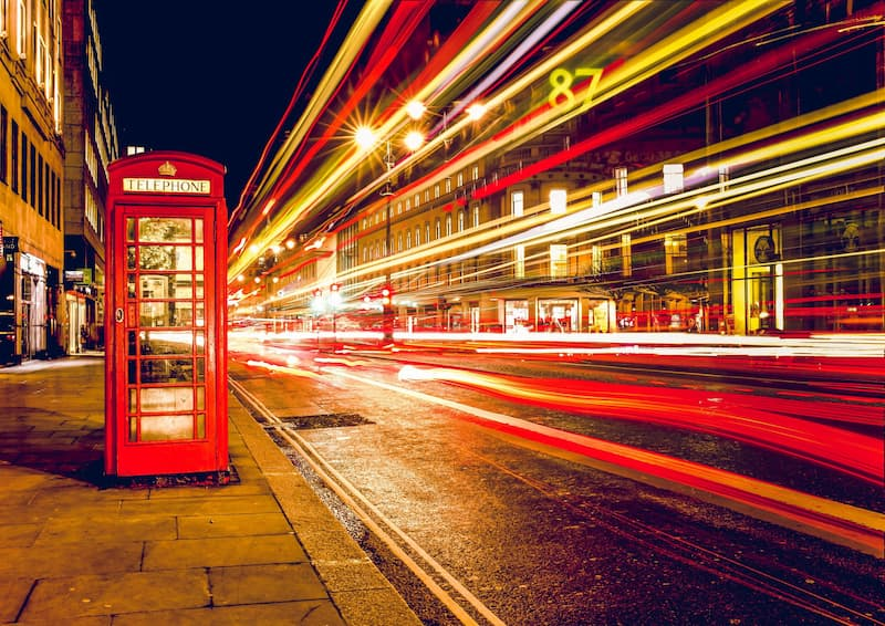 Picture of a phone box and light trail